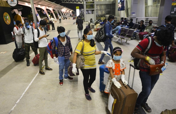 Consider imposing fines on passengers not wearing masks properly: DGCA to airports