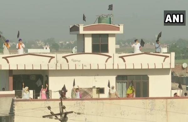 Punjab farmers hoist black flag atop houses to mark six months of protest against agri laws