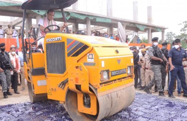 Assam CM Himanta Biswa Sarma drives road roller to destroy 58,000 bottles of seized cough syrups