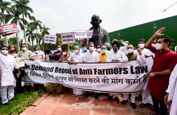 Congress MPs protest inside Parliament complex, demand repeal of new agri laws