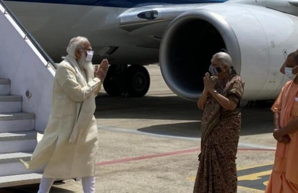 PM Narendra Modi lands in Varanasi, received by Uttar Pradesh Governor Anandiben Patel