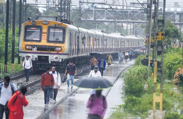 Slum evacuated, train services halted as heavy rain causes flood in Mumbai's low-lying areas
