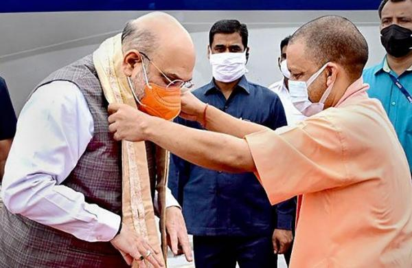 Shah praises Yogi Adityanath for /revamped law and order in UP', says BJP govts work for the poorest