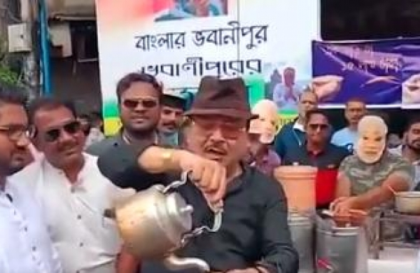 WATCH   TMC's Madan Mitra dons role of 'chaiwala', pegs price of cup at Rs 15 lakh