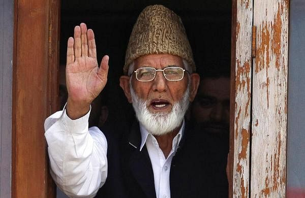 Geelani given quiet burial by police, before sunrise amid high security