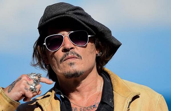 Johnny Depp makes rare red carpet appearance amid legal battle with ex-wife Amber Heard