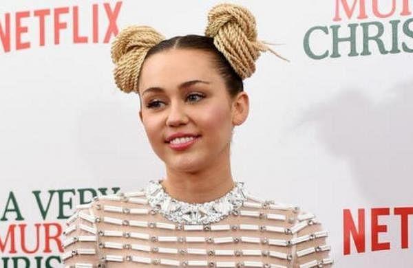Miley Cyrus dances with Megan Thee Stallion at Austin City Limits 2021